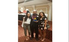 Bertrand with daughters Kylee and Kira at banquet