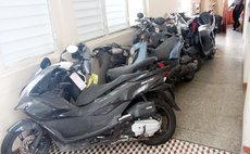 Part of a collection of confiscated bikes at police station