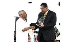 Lawrence Brumant, King of Konte, receives LIME Lifetime Award from President Savarin