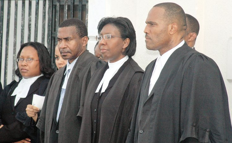 Michael Bruney, second from left, at an official opening of law year