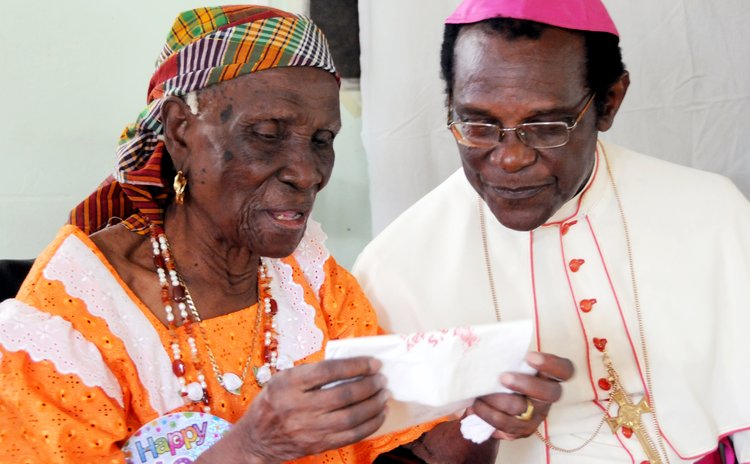 Archbishop Felix and centenarian at Soufriere
