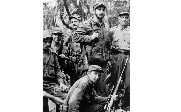Unlocated image taken in 1958 shows Fidel Castro (2nd R), Raul Castro (Down) and Ernesto Guevara (2nd L) posing with arms.