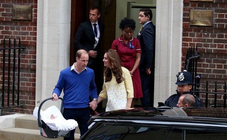Prince William (R), his wife, the Duchess of Cambridge and their new daughter are seen in front of the Lindo Wing of St Mary's Hospital in London, Britain on May 2, 2015