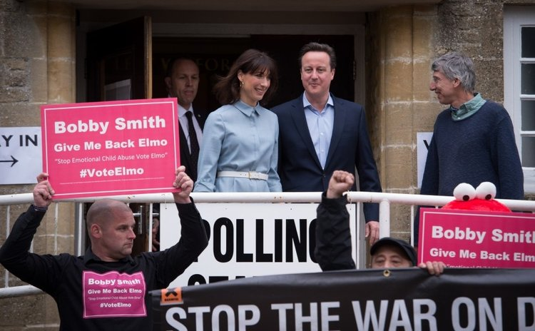 David Cameron, British Prime Minister and leader of the Conservative Party and wife leaves polling station