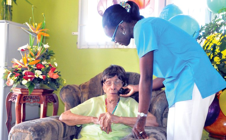 Centenarian Alfreda Georges takes a call on her birthday