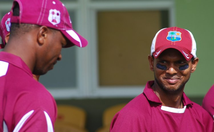 Chanderpaul shares a smile with a teammate