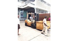Charles drives forklift at business compound