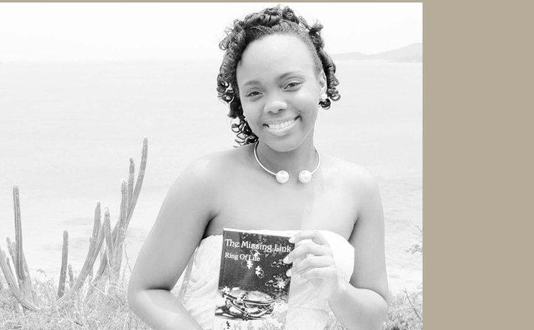 Chelsea Jno Baptiste shows her book