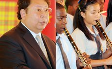 Chinese Ambassador, left, and Chinese student playing in school band
