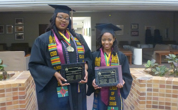 Clivonne Jno Baptiste and Rolanda Ferdinand pose after the graduation ceremony