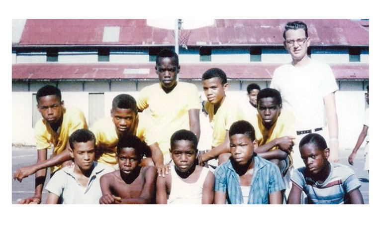 Bro. William Stevens seen here with some youngsters at SMA, was Dominica's State Basketball Team's first coach