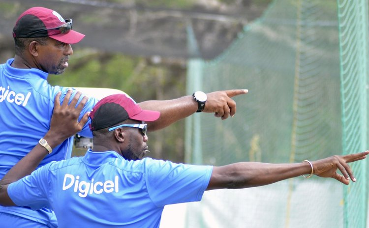 Coach Phil Simmons , left, and Bowling Coach Curtly Ambrose during a West Indies training session