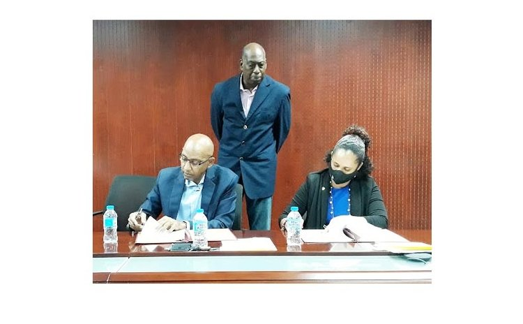 Health officials sign contract