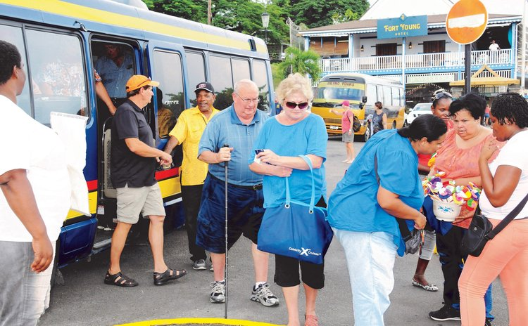Before COVID-19:Tourists leaving a bus on the Roseau Bayfront after a tour