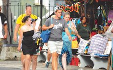 Cruise tourist walk on the Roseau Bayfront