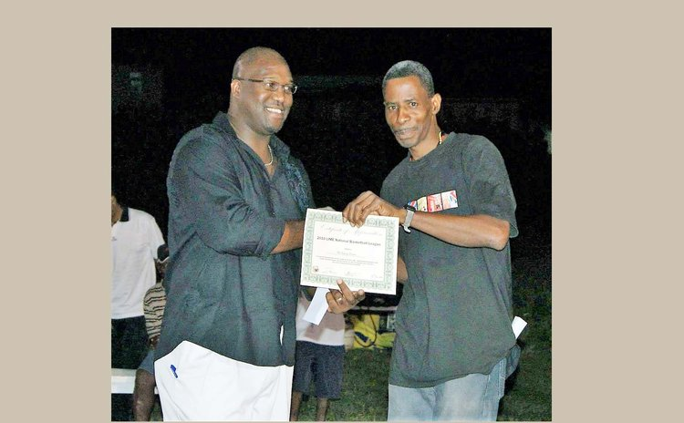 DABA-DBOA Referee Leroy Dover (R) being recognized by DABA President Dave Baron, for long service as a basketball official.   Photo Courtesy: Mickey Joseph