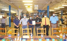 DCP gets new standards certificate: members of DCP staff and Dominica Bureau of Standards