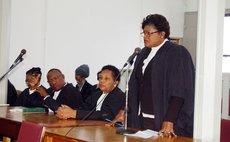 Baptiste, right, addresses court