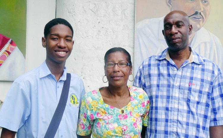Ahmed Jno Baptiste, left, and parents