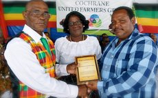 Lifetime Contribution to Agriculture Awarded to Mr. and Mrs. Oscar Francis by the group's President, William Sabaroche.