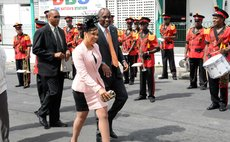Prime Minister Skerrit and Mrs Skerrit aon their way to parliament for the delivery of the budget address on Wednesday 23 July 2014