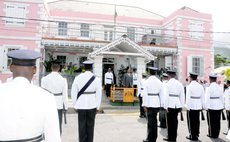 Police officers stand in front of the Dominica House of Assembly, Victoria Street, Roseau