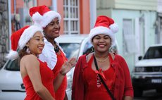Three Kalinago beauties adorn  Roseau's streets on Christmas Eve