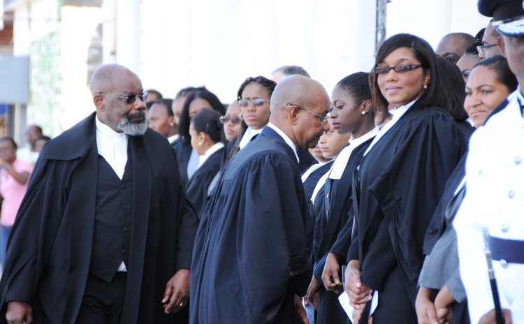 Judge Errol Thomas,lawyers and other officials at the opening of Law Year