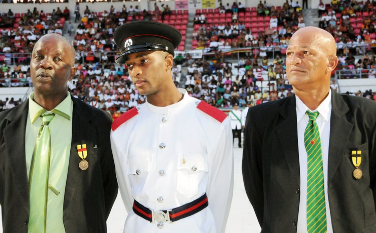 Joseln Jean Piere Prince (center) and his ushers at the Independence 2013 National Awards ceremony