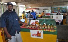 Big G displays pepper sauce at an expo at the Roseau Market