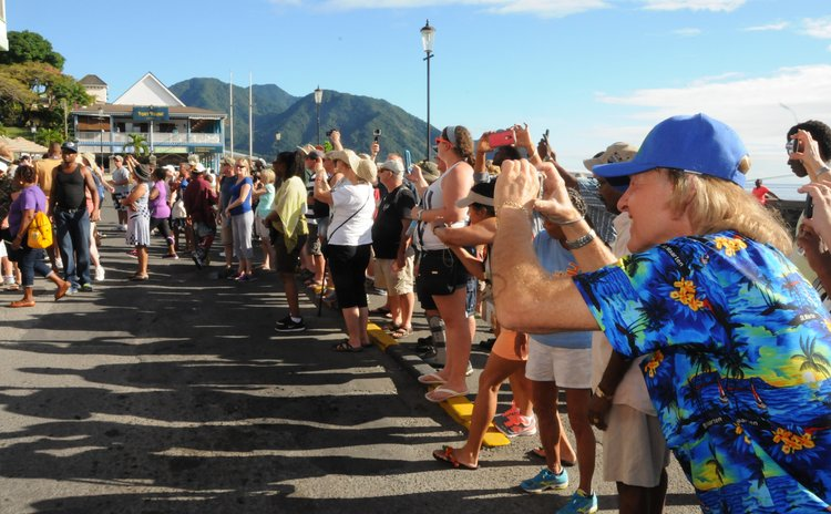 Tourists line up to take pictures on the Bayfront