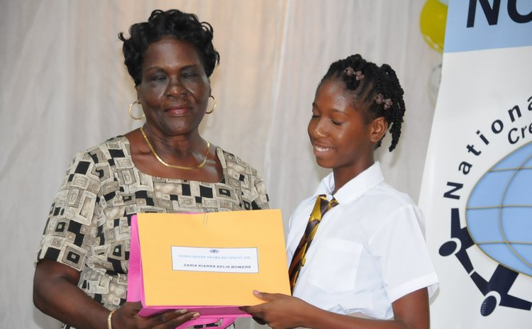 Marie Wilkins Scholarship delivered by Mary Wilkins to Zaria Kiarra Kelis Bowers of Pointe Michel
