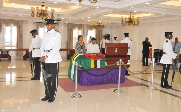 Police and public view coffin at the State House on Thursday
