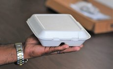 Man holding plastic food container