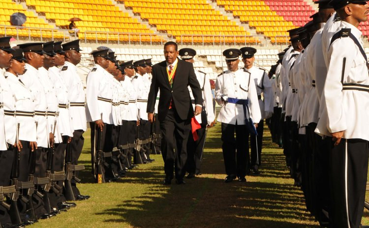 President Charles Savarin inspect the parade
