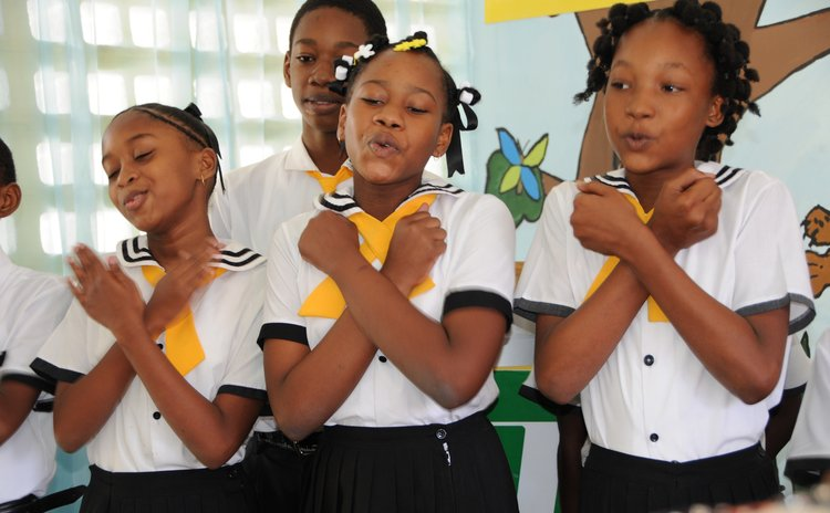Students at the Roseau Primary School  sing at a function
