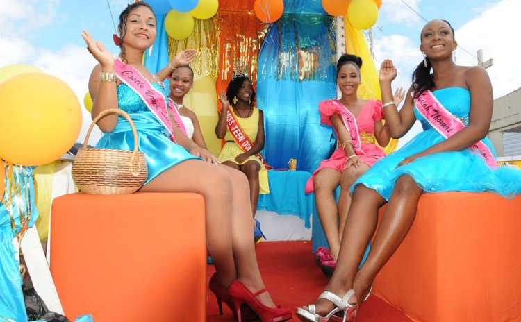 Participants in the Miss Teen pageant parade at the opening of carnival; Shari Peter at right back