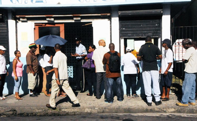 Dominicans vote today in Roseau Central at the WAWU headquarters