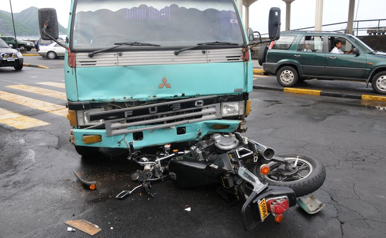 Accident in Roseau: Bike crushed by truck