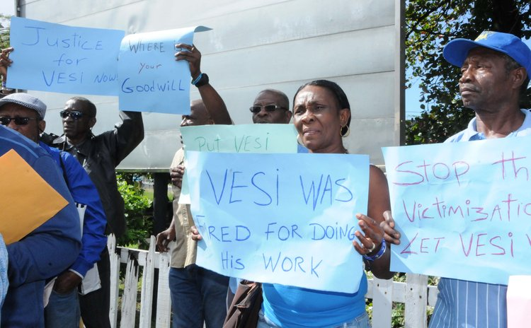 Marigot residents protest near the Port for the reemplyment of Jones