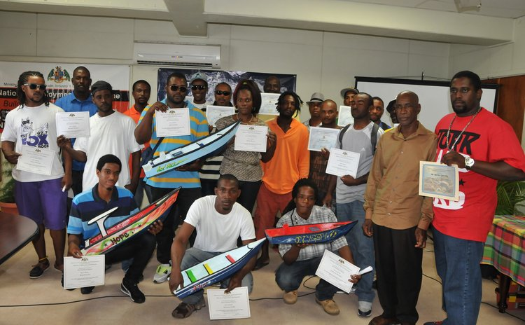 Graduates of the NEP course pose with certificates and models