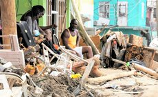 Fanso,centre, sits among the debris of Maria