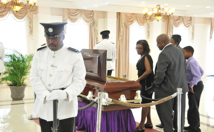 Frderick Baron, right, takes a look at his father's body at the State House this morning