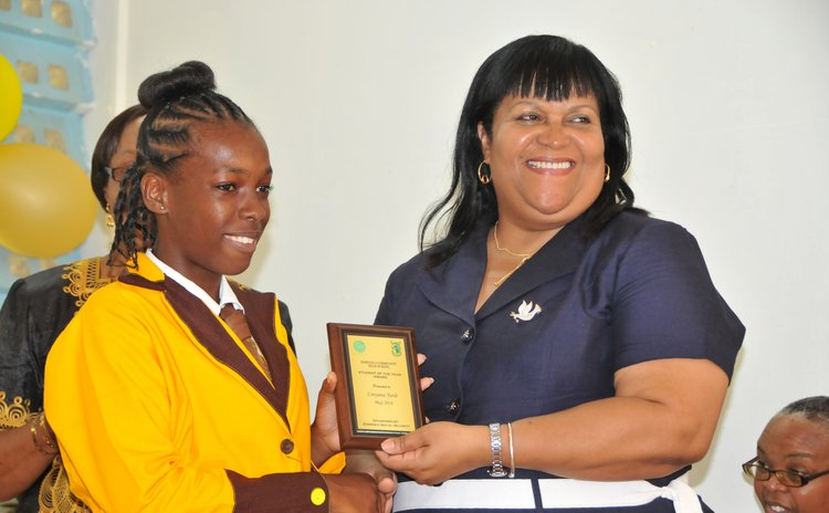 Student of the Year Conyana Yarde receives award from Chief Education Officer Ms Fontaine