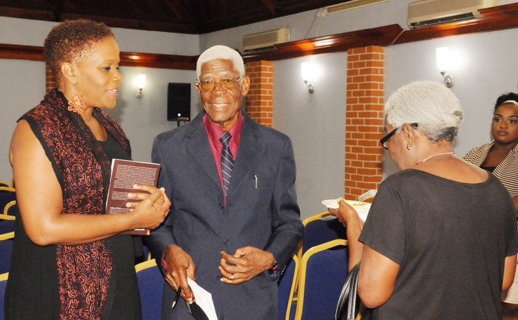 Rev. Dr. Watty, centre at his book launch at the Fort Young Hotel