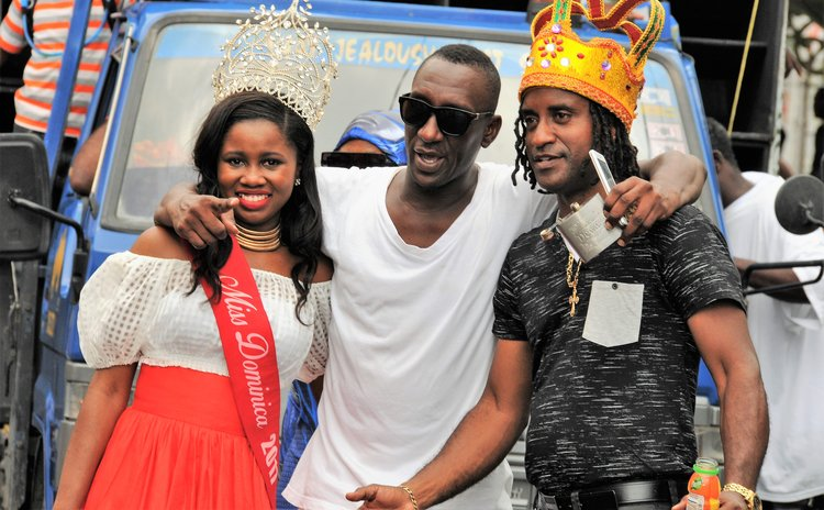 Bobb,right, Miss Dominica 2017 and fan at Carnival 2018 parade
