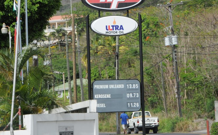 Petrol prices on display outside gas station at Canefield