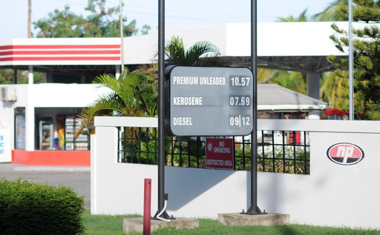 Billboard of gas, kerosene and diesel prices on display outside the NP gas station at Canefield