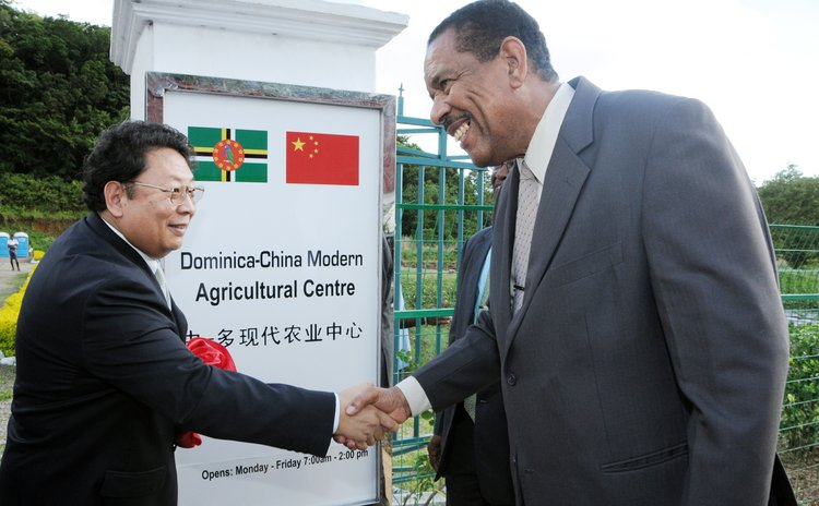 President Savarin (right) and Chinese Ambassador Li Jiangning shake hands after cutting ribbon to officially open the Dominica-China Modern Agricultural Centre at One Mile Portsmouth
