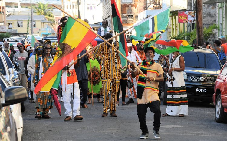 Man waves flag at African Liberation Day parade 2018